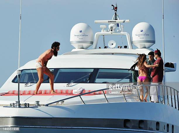 Admiral General Aladeen and supermodel Elisabetta Canalis spotted on a luxury yacht at Hotel Du Cap during 65th Annual Cannes Film Festival on May 16...