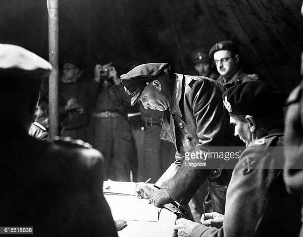 Admiral Hans von Friedeburg surrenders to Field Marshall Sir Bernard Montgomery at Luneburg Heath, May 4, 1945. | Location: Luneberg Heath, lower...