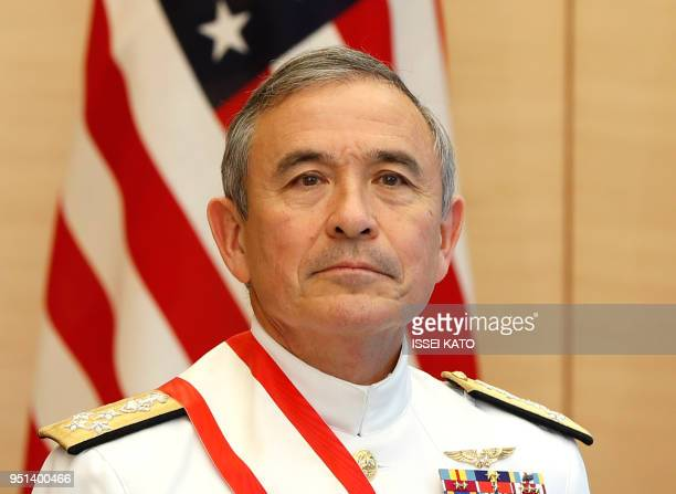 Admiral Harry Harris Commander of the United States Pacific Command waits for arrival of Japan's Prime Minister Shinzo Abe before their meeting at...