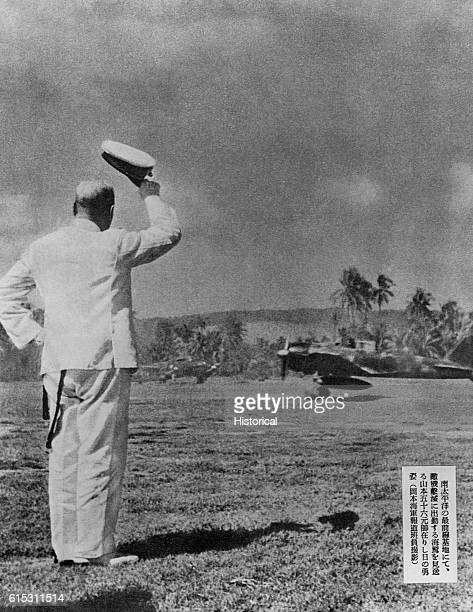 Admiral Isoroku Yamamoto the man in charge of the attack on Pearl Harbor tips his hat to a fighter aircraft taking off on Guadacanal