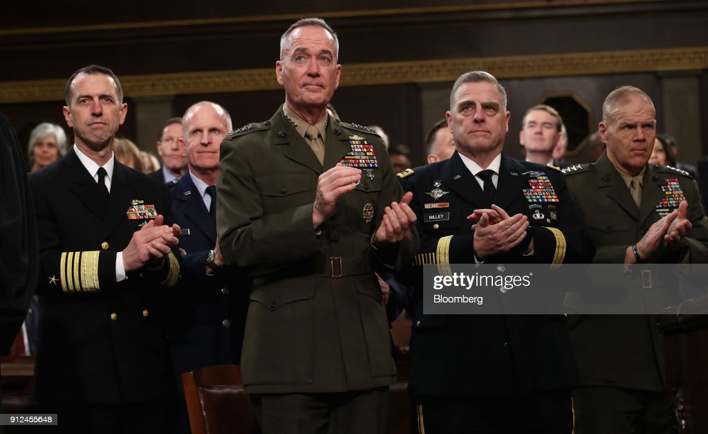 Admiral John Richardson, chief of Naval Operations, from left, General David Goldfein, chief of staff of the Air Force, General Joseph Dunford, chairman of the Joint Chiefs of Staff, General Mark Milley, chief of staff of the Army, and General Robert Neller, commandant of the Marine Corps., applaud after U.S. President Donald Trump, not pictured, delivered a State of the Union address to a joint session of Congress at the U.S. Capitol in Washington, D.C., U.S., on Tuesday, Jan. 30, 2018. Photographer: Win McNamee/Pool via Bloomberg