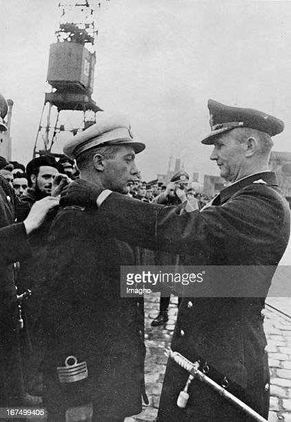 Admiral Karl Dönitz decorates Enzo Grossi for the sinking of the American battleship Mississippi with the Knight's Cross. December 8th 1942....