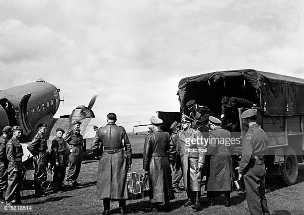 Admiral Karl Doenitz and Colonel General Alfred Gustav Jodl surrender to the British at Lumenburg Heath, May 5, 1945. | Location: Luneberg Heath,...