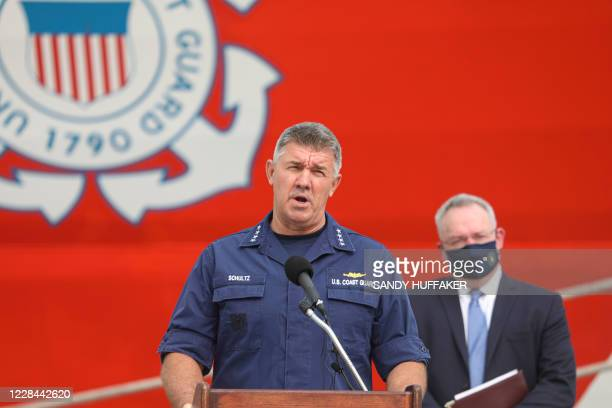 Admiral Karl Schultz Commandant of the US Coast Guard speaks during a press conference in front of the Cutter Bertholf on September 10 2020 in San...