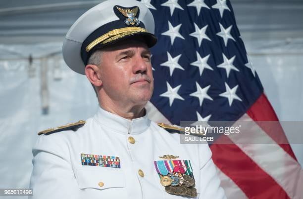 Admiral Karl Schultz speaks after becoming the Commandant of the US Coast Guard during a Change of Command ceremony at US Coast Guard Headquarters in...