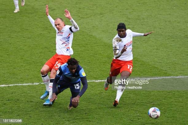 Admiral Muskwe of Wycombe Wanderers tackled by Kal Naismith of Luton Town to give away a penalty leading to Wycombe during the Sky Bet Championship...