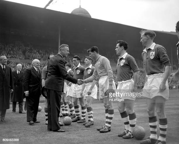 Admiral of the Fleet Earl Mountbatten of Burma shakes hands with Ireland goalkeeper Alan Kelly ahead of the match England went on to win the game 51