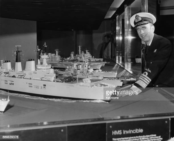 Admiral Raymond Lygo Vice Chief of the Naval Staff looks at a model of the new aircraft carrier 'HMS Invincible' at the Royal Navy stand at the Daily...