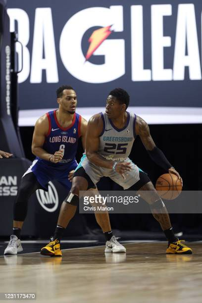 Admiral Schofield of the Greensboro Swarm posts up on Elie Okobo of the Long Island Nets on February 14, 2021 at HP Field House in Orlando, Florida....