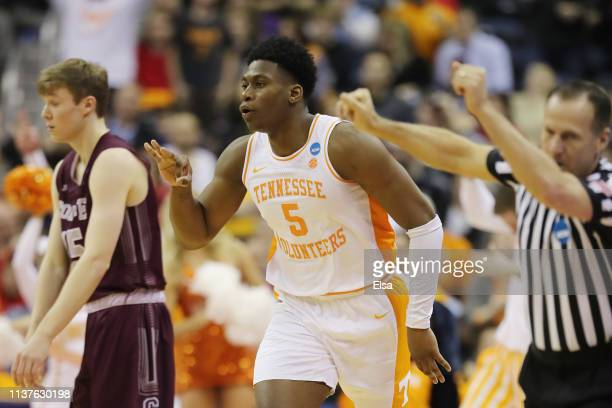 Admiral Schofield of the Tennessee Volunteers celebrates after a three point basket during the second half against the Colgate Raiders in the first...