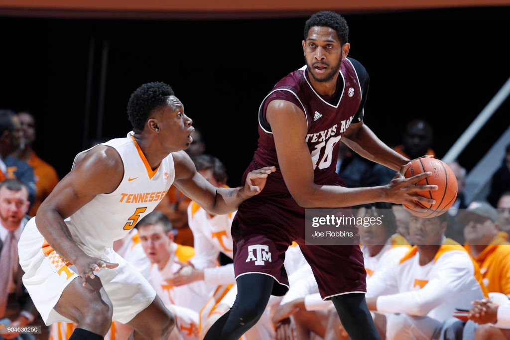 Admiral Schofield #5 of the Tennessee Volunteers defends against Tonny Trocha-Morelos #10 of the Texas A&M Aggies in the first half of a game at Thompson-Boling Arena on January 13, 2018 in Knoxville, Tennessee. Tennessee won 75-62.