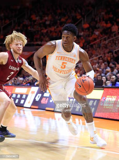 Admiral Schofield of the Tennessee Volunteers dribbles the ball against the South Carolina Gamecoacks at ThompsonBoling Arena on February 13 2019 in...