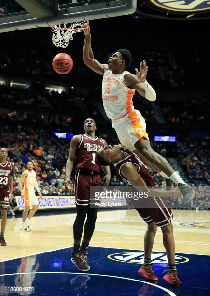 Admiral Schofield of the Tennessee Volunteers dunks the ball against the Mississippi State Bulldogs during the Quarterfinals of the SEC Basketball...