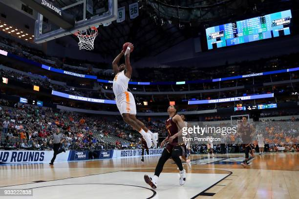 Admiral Schofield of the Tennessee Volunteers dunks the ball past Lucas Williamson of the Loyola Ramblers in the first half during the second round...