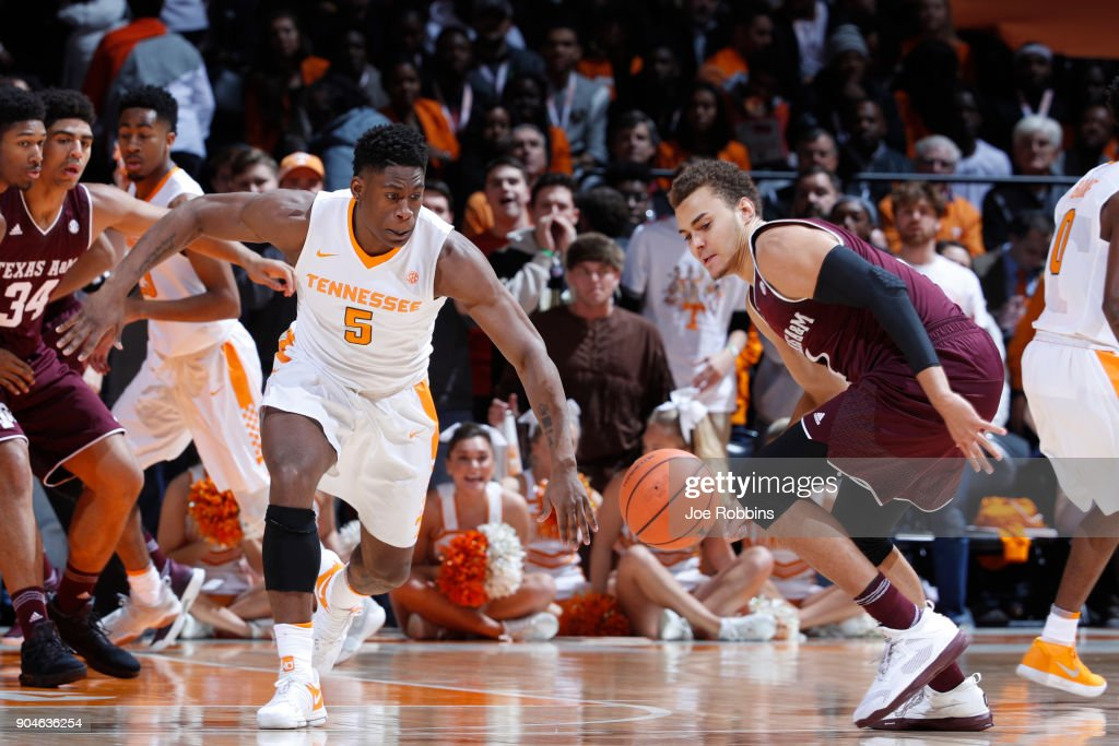 Admiral Schofield #5 of the Tennessee Volunteers goes for a loose ball against DJ Hogg #1 of the Texas A&M Aggies in the first half of a game at Thompson-Boling Arena on January 13, 2018 in Knoxville, Tennessee. Tennessee won 75-62.