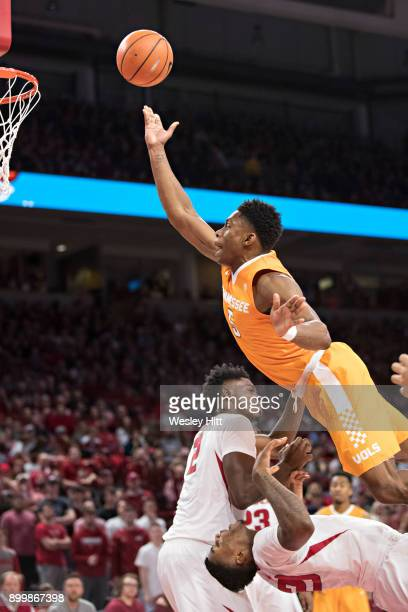 Admiral Schofield of the Tennessee Volunteers goes up for a shot and is called for a charge over Darious Hall of the Arkansas Razorbacks at Bud...