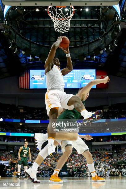 Admiral Schofield of the Tennessee Volunteers grabs a rebound over Loudon Love of the Wright State Raiders in the first half in the first round of...