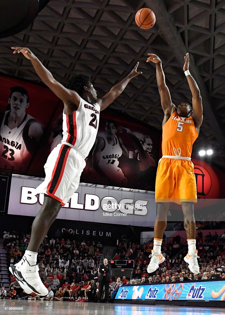 Admiral Schofield #5 of the Tennessee Volunteers shoots over Rayshaun Hammonds #20 of the Georgia Bulldogs during the basketball game at Stegeman Coliseum on February 17, 2018 in Athens, Georgia.