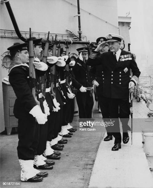 Admiral Sir Alexander Bingley of the Royal Navy the CommanderinChief Portsmouth and Rear Admiral Michel Prache of the French Navy inspect a guard of...