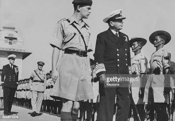 Admiral Sir Arthur Palliser British East Indies Naval Commander in Chief and Captain R G Meath inspecting a Guard of Honor of the 6th Gurkhas from...
