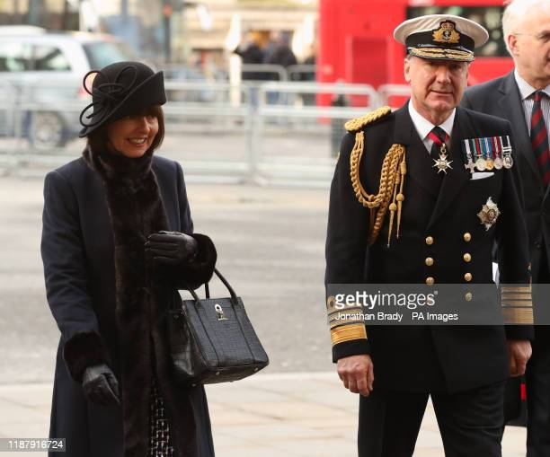 Admiral Sir George Michael Zambellas with his wife Amanda arriving for a service of thanksgiving for the life and work of Sir Donald Gosling at...