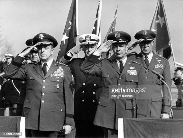 Admirals and generals of the US Army saluting during a military parade in honor of the taking over of the new headquarter of the US forces in Europe...