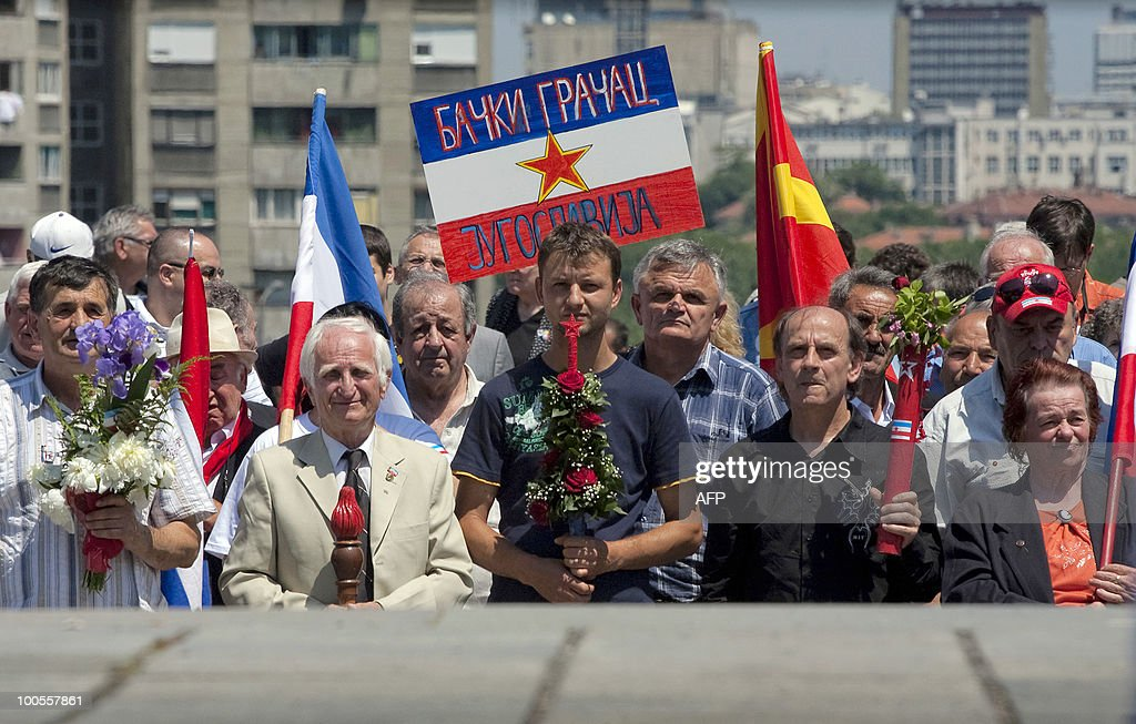 Admirers of the late Yugoslav communist president Josip Broz Tito hold batons and flags of the former communist state in front of his memorial complex in Belgrade on May 25, 2010. People from various parts of former Yugoslavia flocked to Tito's grave to mark his birthday. Marking Tito's birthday a baton with a birthday pledge from all young people of former Yugoslavia was carried through all major towns and cities of the country. AFP PHOTO / Dalibor DANILOVIC