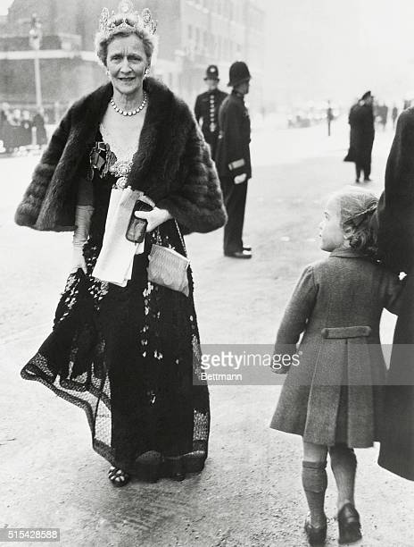 Admiring A Lady. London: A tiny Londerer can't take her eyes off the jeweled tiara and fur cape worn by American born Lady Astor as the latter...