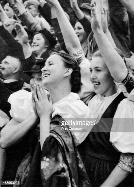 Admiring crowd saluting German Nazi leader Adolf Hitler 1938 A print from Wie die Oftmark ihre Befreiung erlebte Berlin 1940