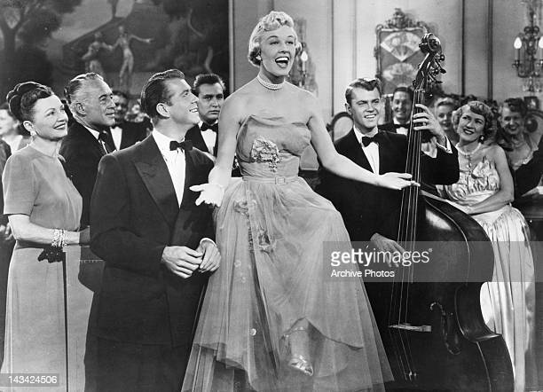 Admiring Gene Nelson looking up at singing Doris Day in a scene from the film 'Lullaby Of Broadway' 1951