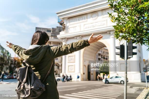 admiring porta macedonia - skopje stock pictures, royalty-free photos & images