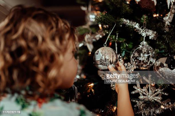 admiring the christmas decorations - tinsel stock pictures, royalty-free photos & images