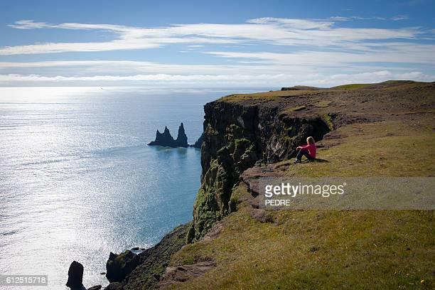 Admiring the Reynisdrangar rock formations