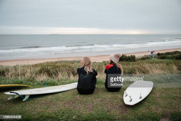 admiring the view before a morning surf - tyne and wear stock pictures, royalty-free photos & images