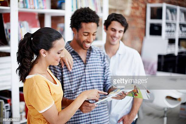 admiring their results - mixed magazine stock photos and pictures