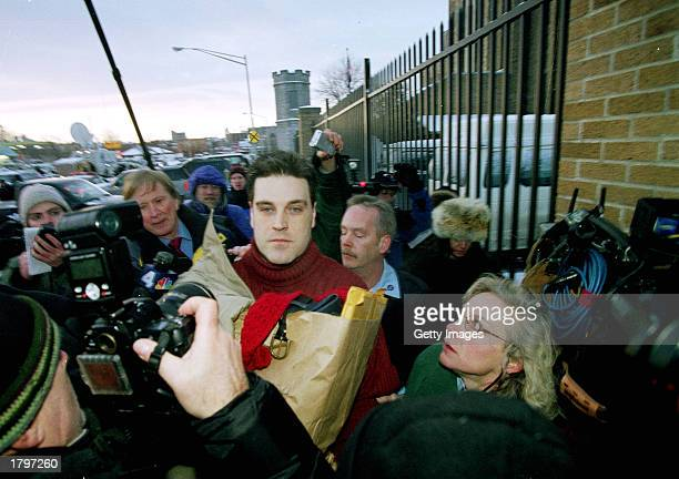 Admitted 'Preppie Killer' Robert Chambers is surrounded by media personnel as he walks away from Auburn Prison February 14 2003 in Auburn New York...