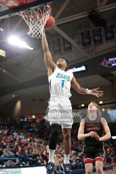 Admon Gilder Jr #1 of the Gonzaga Bulldogs goes to the basket against Jack Perry of the Eastern Washington Eagles in the first half at McCarthey...