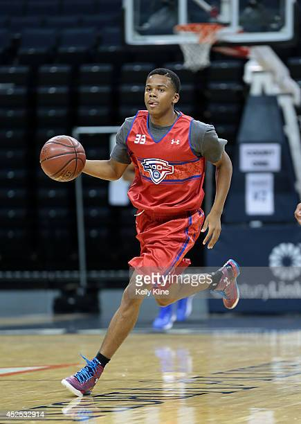 Admon Gilder Jr in red brings the ball up the court during the National Basketball Players Association Top 100 Camp on June 17 2014 at John Paul...