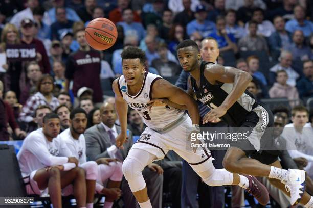 Admon Gilder of the Texas AM Aggies competes for the ball with Alpha Diallo of the Providence Friars in the first round of the 2018 NCAA Men's...