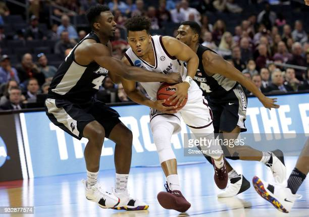 Admon Gilder of the Texas AM Aggies drives the ball against Isaiah Jackson of the Providence Friars during the first round of the 2018 NCAA Men's...