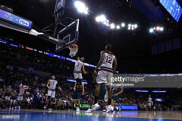 Admon Gilder of the Texas AM Aggies dunks the ball in the second half against the Green Bay Phoenix during the first round of the 2016 NCAA Men's...