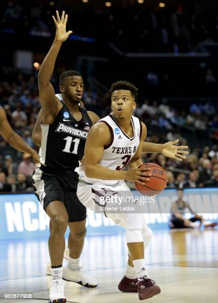 Admon Gilder of the Texas AM Aggies looks to the basket against Alpha Diallo of the Providence Friars during the first round of the 2018 NCAA Men's...
