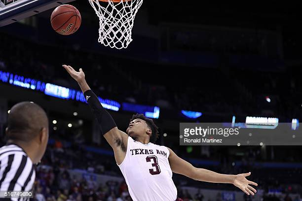 Admon Gilder of the Texas AM Aggies makes a layup to tie up the game with a score of 71 to 71 to bring them into overtime against the Northern Iowa...