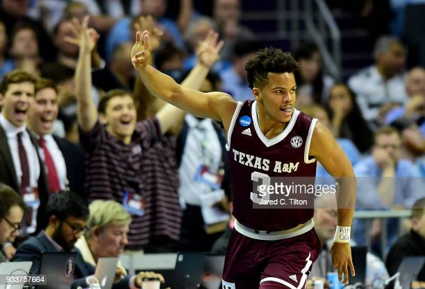Admon Gilder of the Texas AM Aggies reacts after a three point shot against the North Carolina Tar Heels during the second round of the 2018 NCAA...