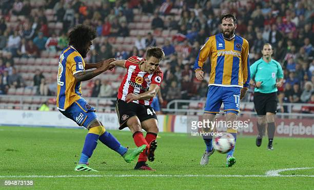 Adna Januzaj of Sunderland scores the first goal during the EFL Cup second round match between Sunderland AFC and Shrewsbury Town FC at Stadium of...