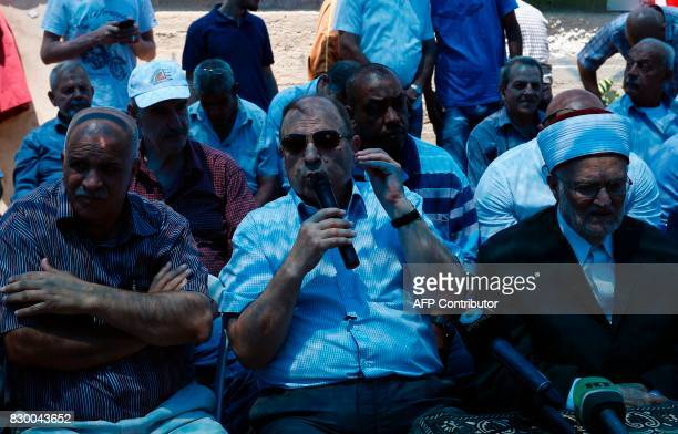 Adnan alHusayni Palestinian governor of Jerusalem and Palestinian minister in charge of Jerusalem speaks at a gathering in a street leading to the...