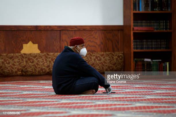 Adnan Ell Kadri listens to prayers in a nearly empty room at Masjid AlSalaam on the first full day of Ramadan on April 24 2020 in Dearborn Michigan...