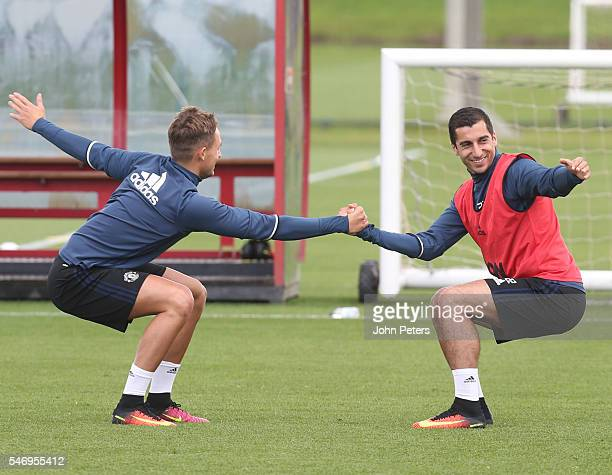Adnan Januzaj and Henrikh Mkhitaryan of Manchester United in action during a first team training session at Aon Training Complex on July 13 2016 in...