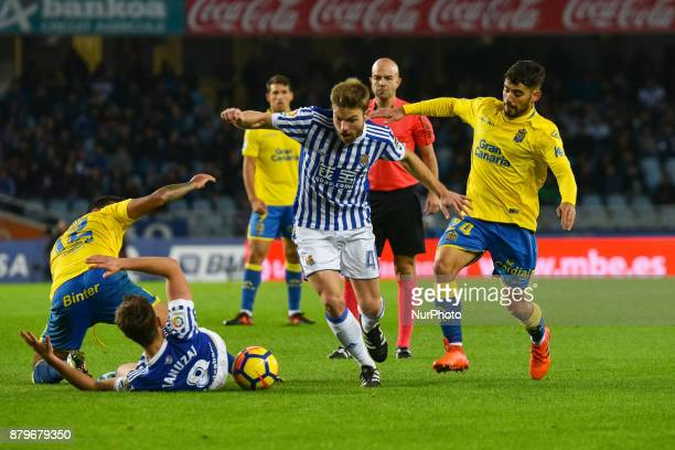 Adnan Januzaj and Illarramendi of Real Sociedad duels for the ball with Michel and Tana of U D Las Palmas during the Spanish league football match...