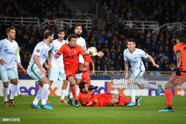 Adnan Januzaj and Oyarzabal of Real Sociedad vies with Miha Mevlja and Aleksandr Erokhin of Zenit during the UEFA Europa League Group L football...
